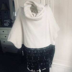 Sweaters - Ivory poncho sweater with black lace trim